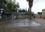 Foreclosed Home in Escalon 95320 2101 JACKSON AVE - Property ID: 4230580