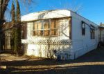 Foreclosed Home in Kingman 86409 3215 E DEVLIN AVE - Property ID: 4247004