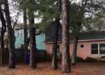 Foreclosed Home in Oak Island 28465 101 NE 62ND ST - Property ID: 4254237