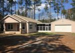Foreclosed Home in Freeport 32439 154 SWEETWATER LN - Property ID: 4259199