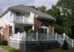Foreclosed Home in Oak Island 28465 3103 E OAK ISLAND DR - Property ID: 4161084