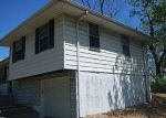 Foreclosed Home in Kansas City 64119 4831 N SMALLEY AVE - Property ID: 4279971